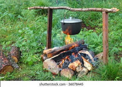 Kettle (pot) with fish soup on the campfire.