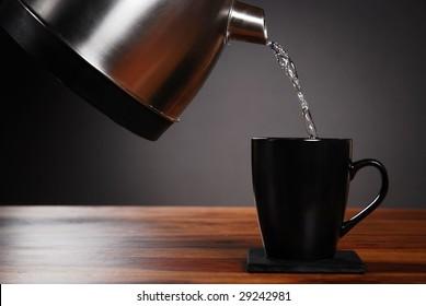Kettle pouring into mug