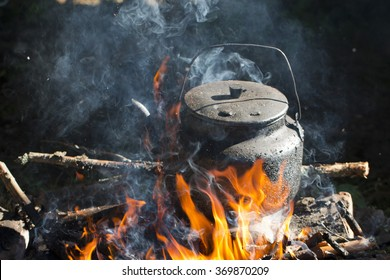 kettle put in fire place outdoor