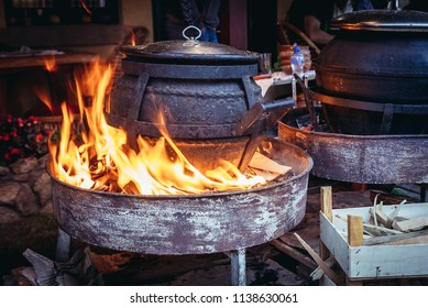 Kettle with stew on a gastronomic stand during famous Trumpet Festival in Guca, Serbia