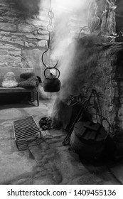 A kettle warming over an open peat fire in an 1800s Orkney island farmhouse.
