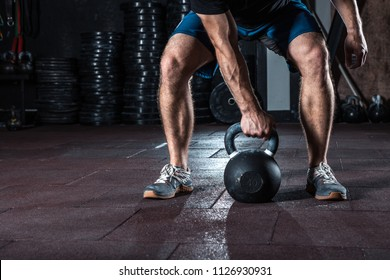 Kettlebell  crossfit training in gym. Athlete doing workout