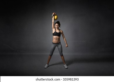 kettlebell training for a girl, dark background