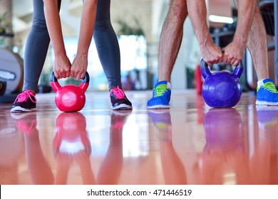 Kettlebells swing exercise man and woman workout at gym