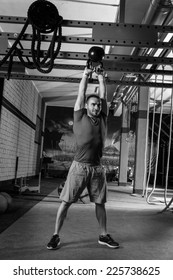 kettleblell swinging man weightlifting workout exercise at gym