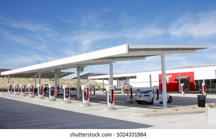 Kettleman City, CA - February 02, 2017: Tesla Supercharger station with 40 charging stations all on solar power. Supercharger stations allow Tesla cars to be fast-charged at the network within a hour.