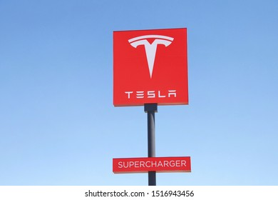 Kettleman City, CA - Sept 28, 2019: Sign at Tesla Super Charging station in Kettleman City off the 5 freeway. Supercharger stations allow Tesla cars to be fast-charged at the network within an hour.