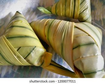 Ketupat daun palas, a triangle version of the ketupat is ready for cooking