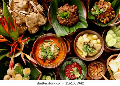 Ketupat Lebaran. Traditional celebratory dish of rice cake with several side dishes, popularly served during Eid celebrations.