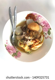 Ketupat or lontong sayur, Indonesian cuisine, Special dish served at Eid Mubarak /Eid Fitr celebration. It consist of ketupat served with chicken and egg.