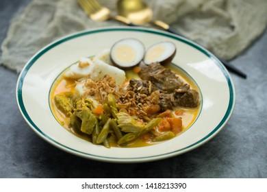 Ketupat or lontong sayur, Indonesian cuisine, Special dish served at Eid Mubarak /Eid Fitr celebration.