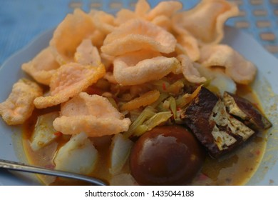 Ketupat or Lontong Sayur is an Indonesian specialty made from rice and vegetable curry, served with eggs, chicken curry and crackers. This food is usually served in the morning or evening