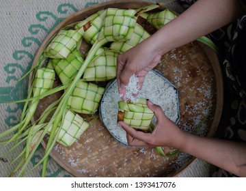 Ketupat, a natural rice casing made from young coconut leaves for cooking rice. and Ketupat is favorite menu on Idul Fitri celebrations