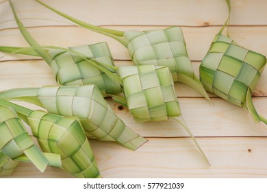 Ketupat on wooden background. Ketupat is a local delicacy during the festive season in South East Asia.