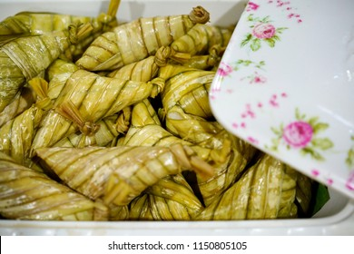 Ketupat palas, a Malay delicacy made from glutinous rice and coconut milk packed inside a diamond shaped container made of woven leaf also knowm as daun palas