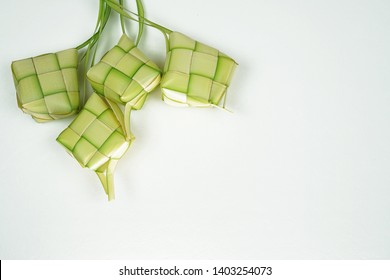 Ketupat or rice dumpling a famous main course during the festive season.Ketupat's, a rice casing made from young coconut leaves for cooking rice on a white background.