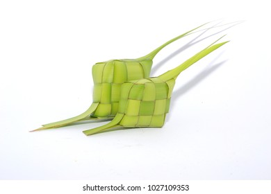 Ketupat or rice dumpling is a local delicacy during the festive season. Ketupats, a natural rice casing made from young coconut leaves for cooking rice on a white background