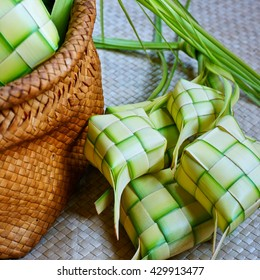 Ketupat (rice dumpling) on a traditional mat which is a local delicacy during the festive season in South East Asia. Ketupat, a natural rice casing made from young coconut leaves for cooking rice.