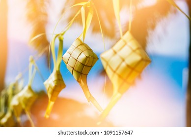 Ketupat (Rice Dumpling) On vintage jute cloth with artificial light effects. Ketupat is a natural rice casing made from young coconut leaves for cooking rice during eid Mubarak  Eid ul Fitr
