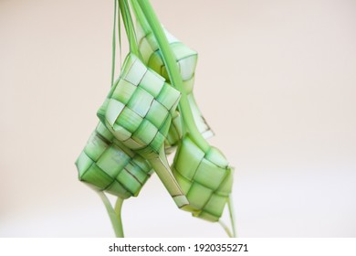 Ketupat (Rice Dumpling) On White Background. Ketupat is a natural rice casing made from young coconut leaves for cooking rice during eid Mubarak, Eid ul Fitr