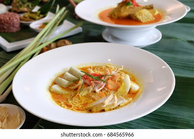 Ketupat Sayur or ketupat in vegetables soup or is Indonesia food served with cooked tofu and spiced boiled egg on a plate.