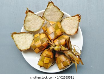 Ketupat, special dish served at Eid Mubarak / Ied Fitr celebration in Indonesia. Ketupat is  is a type of dumpling made from rice packed inside a diamond-shaped container of woven palm leaf pouch.