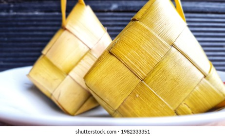 Ketupat, a typical dish served at Eid celebrations  Idul Fitri in Indonesia or Southeast Asia. made from rice which is packaged in a woven bag of young coconut or palm leaves in the shape of a diamon