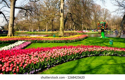 Keukenhof, the Netherlands, April 14, 2018. Beautiful spring flowers: red tulips, yellow daffodils, delicate hyacinths in the famous Keukenhof park in the Netherlands in early spring on a sunny day.
