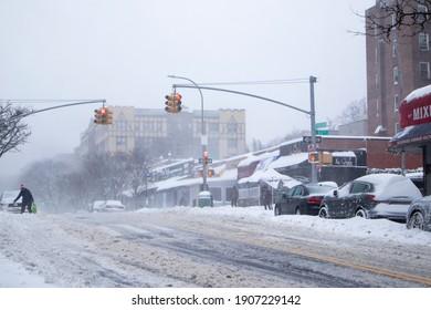 Kew Gardens, NY, USA - February 1st, 2021: Snow storm on East Coast 02.01.2021. Metropolitan Av crossing 83th street Av
