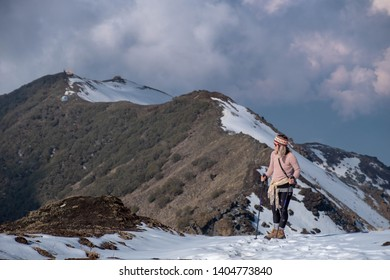 Kew, Nepal - May 16,2019: Stacie Yokiel climbs to the Upper View point on the Mardi Himal Trek.