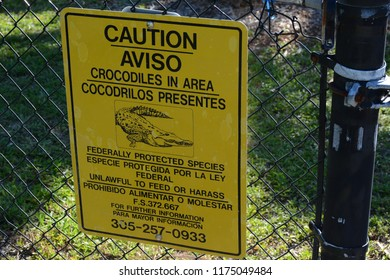 KEY BISCAYNE, FL, USA - APRIL 17, 2018: Crocodiles caution sign in Crandon park  located in Key Biscayne near Miami