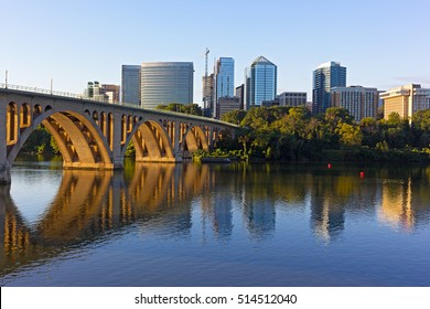 Key Bridge and Rosslyn skyline in early morning, Washington DC, USA. A view n Potomac River from Georgetown Park in US capital.