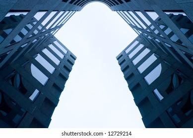 key business concept - symmetrical steel blue business building forms a solid white keyhole shape