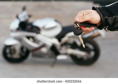key exchange. Motorcycle concept.