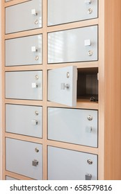 Key hanging from the locker doors opening, wooden locker interior design