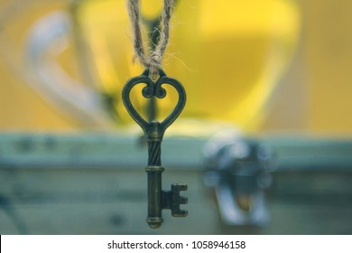 The key hangs over the locked antique box