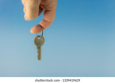 A key is held with one finger