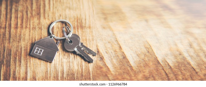 key with house figure on table