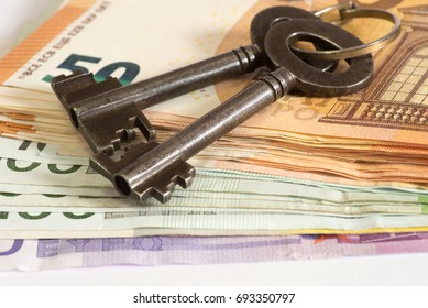 A key for a house and many euro banknotes