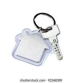 Key with a house key ring, home symbol.