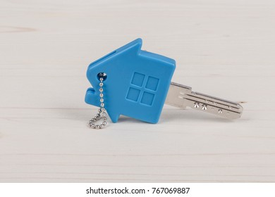 a key with house shaped blue keyring