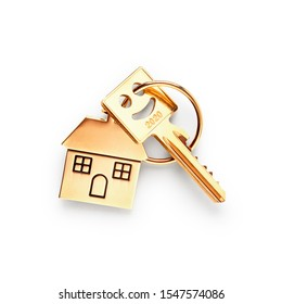 Key with house shaped keychain and number 2020 isolated on white background clipping path included. Design element, top view, flat lay. Happy new year 2020 concept