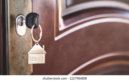 Key in keyhole with metal house.