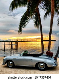 Key Largo, Florida / USA - July 23, 2016  Classic 1950's Porsche 356 Speedster next to water staged for wedding shoot at sunset.