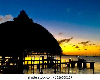 Key Largo sunset with Tiki Hut in foreground