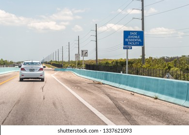 Key Largo, USA - April 30, 2018: Keys car on overseas highway road in Florida with sign near Miami for Dade Juvenile Residential Facility
