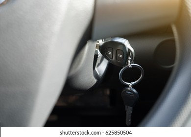 A key is left inside a car. To prevent your car from being stolen, drivers should aware that forgetting key inside car make a risk of their car lost.