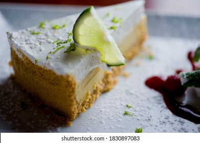 Key Lime Pie. Classic traditional American dessert favorite. Key lime pie, raw mixture made with the juice from Key West lime juice, condensed milk sugar and eggs poured into graham cracker crust.