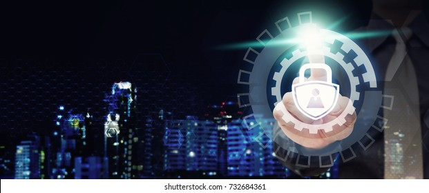 Key lock icon for security concept : Programmer touch key lock icon for secure data center and system, modern city night scene