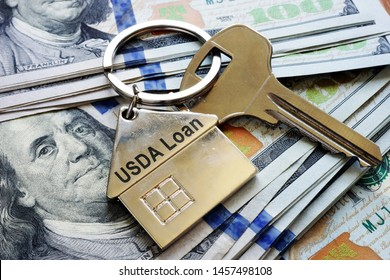 Key and metal shape of home with sign USDA loan.